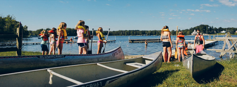 Campers about to put their canoes in the water