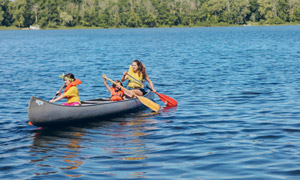Counselor and campers canoeing