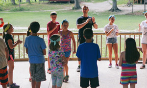 Counselor and campers dancing