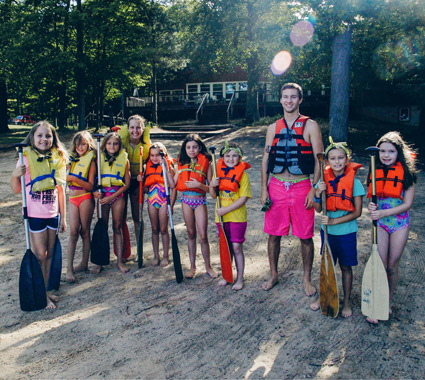 Campers in life jackets with paddles