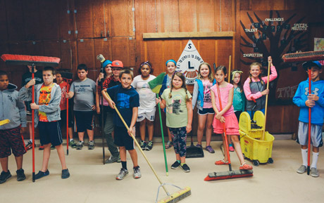 Campers sweeping the lodge